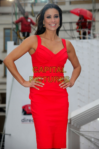 Melanie Sykes .Photocall for 'Direct Line', Covent Garden, London, England..25th October 2012.half length red dress hands on hips  .CAP/JEZ  .©Jez/Capital Pictures.