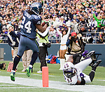 Seattle running back Marshawn Lynch runs for 21 yards after catching a pass from quarterback Tarvaris Jackson in the first quarter against the Baltimore Ravens at  CenturyLink Field in Seattle, Washington on November 13, 2011. Lynch, who rushed for 109 yards on 32 carries and scored one touchdown, was knocked out of bound by Raven linebacker Jameel McClain as the Seahawks beat the Ravens 22-17. ©2011. Jim Bryant Photo. All Rights Reserved.