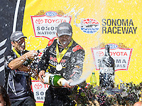 Jul 31, 2016; Sonoma, CA, USA; NHRA top fuel driver J.R. Todd (right) and pro stock driver Greg Anderson celebrate with champagne after winning the Sonoma Nationals at Sonoma Raceway. Mandatory Credit: Mark J. Rebilas-USA TODAY Sports