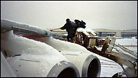 BNPS.co.uk (01202 558833)Pic: SteveHuntClearing snow from a BAe 146 in Sarajevo in 1996.<br /> <br /> A new book gives an intimate look behind the scenes of the Royal Flight and also the flying Royals.<br /> <br /> Starting in 1917 the book charts in pictures the 100 year evolution of first the King's Flight and then later the Queen's Flight as well as the Royal families passion for aviation.<br /> <br /> Author Keith Wilson has had unprecedented access to the Queen's Flight Archives to provide a fascinating insight into both Royal and aeronautical history.