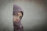 Green eyes spy to the camera. Photo by Sanad Ltefa