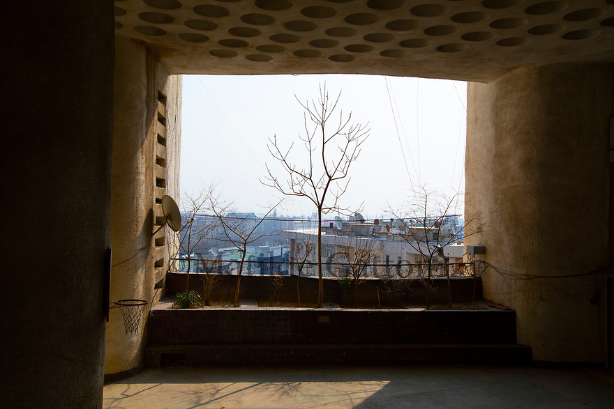 Uzbekistan - Tashkent - View of the city from The Pearl. This 17-storey-building is one of the finest examples of Soviet brutalism in Tashkent. Flats were built around a series of internal squares (each serving three floors) that can be used as gardens, playgrounds or gathering places, reinforcing community spirit and cooperation among residents.