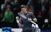 Novak Djokovic of Serbia celebrates after winning his singles round robin match against John Isner of The United States<br /> <br /> Photographer Rob Newell/CameraSport<br /> <br /> International Tennis - Nitto ATP World Tour Finals Day 2 - O2 Arena - London - Sunday 12th November 2018<br /> <br /> World Copyright &copy; 2018 CameraSport. All rights reserved. 43 Linden Ave. Countesthorpe. Leicester. England. LE8 5PG - Tel: +44 (0) 116 277 4147 - admin@camerasport.com - www.camerasport.com