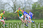 Jason Hickson of Annascaul breaks away from Finuge's  John McCarthy in the Credit Union County League Division 2 last Sunday in Finuge.