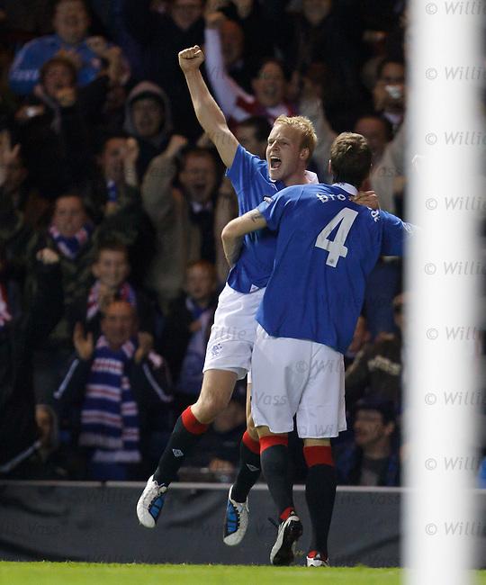 Steven Naismith leaps for joy after scoring for Rangers