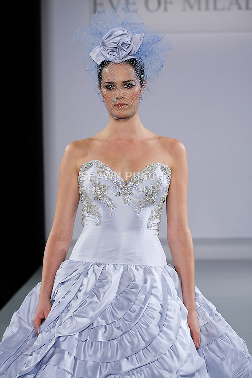 Model walks runway in bridal dress from the Amalia Carrara Fall 2013 collection by Eve Muscio, during Couture New York Bridal Fashion Week, October 12, 2012.