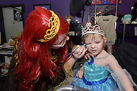 Aliyah Reeve, 2, the daughter of Wendy, reacts to her make-up applied by professional face and body artist Cat Cabajar at the Princess make-up party held at The Painted Cat.