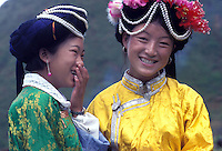 "Mosuo women in traditional costume at the fertility festival dedicated to the God Ganmo. At the festival women are able to select a mate and it is one of the highlights of the Mosuo calander. Women from the Mosuo tribe do not marry, take as many lovers as they wish and have no word for ""father"" or ""husband"". But the arrival of tourism and the sex industry is changing their culture...PHOTO BY SINOPIX"