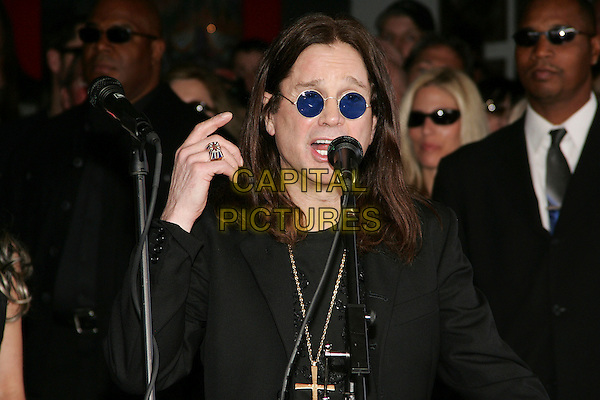 OZZY OSBOURNE.Zack Wylde Induction into the Hollywood RockWalk, Hollywood, California ..January 17th, 2006.Photo: William Scott/AdMedia/Capital Pictures.Ref: WS/ADM.headshot portrait sunglasses shades microphone hand ring.www.capitalpictures.com.sales@capitalpictures.com.© Capital Pictures.