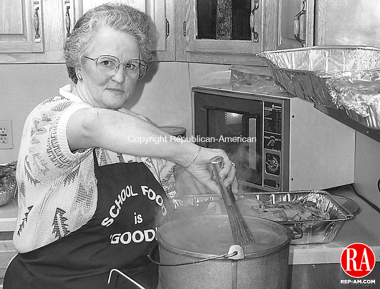 November 26, 1992 - SOUTHINGTON - Shirley Mason, treasurer of the Bread for Life soup kitchen in Southington, stirs a pot of gravy for Thanksgiving Dinner. Photo by Harry Kyle Republican-American