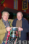 St Michaels/Foilmore fans Brendan Murphy and Mike Day with the All-Ireland Intermediate cup outside the Shebeens bar, Caherciveen on Monday