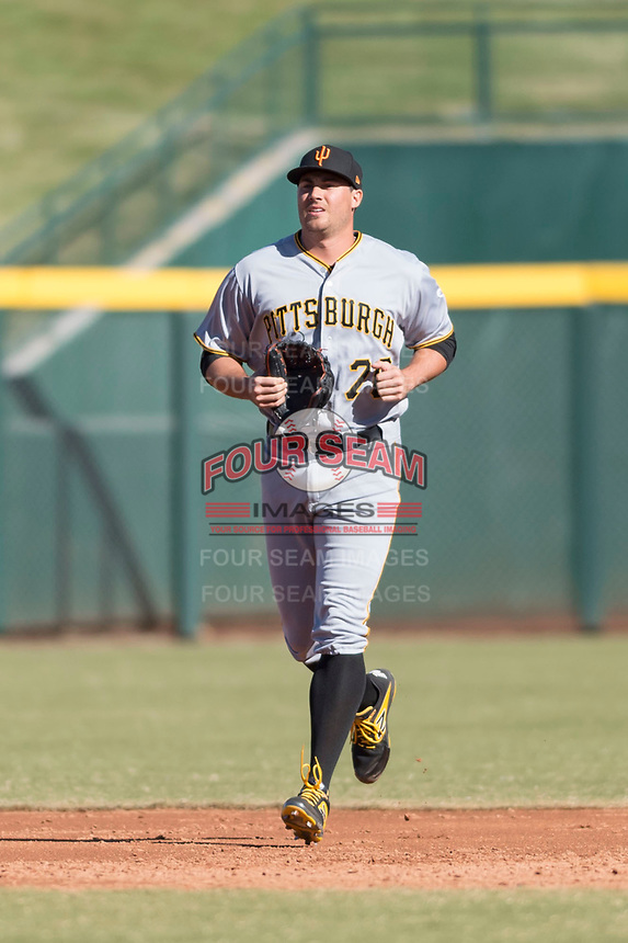 Surprise Saguaros relief pitcher Geoff Hartlieb (70), of the Pittsburgh Pirates organization, jogs onto the field during a pitching change in an Arizona Fall League game against the Mesa Solar Sox at Sloan Park on November 15, 2018 in Mesa, Arizona. Mesa defeated Surprise 11-10. (Zachary Lucy/Four Seam Images)