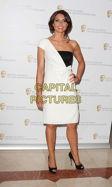 CHRISTINE BLEAKLEY.British Academy Television Craft Awards at the Hilton, Park Lane, London, England, UK, May 23rd 2010.BAFTA full length dress black white one shoulder hand on hip peep toe shoes bow .CAP/ROS.©Steve Ross/Capital Pictures
