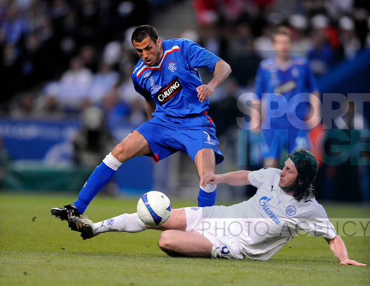 Brahim Hemdani of Rangers and Fatih Tekke of Zenit St Petersburg during the Europa League Final match at The Etihad Stadium, Manchester. Picture date 14th May 2008. Picture credit should read: Simon Bellis/Sportimage