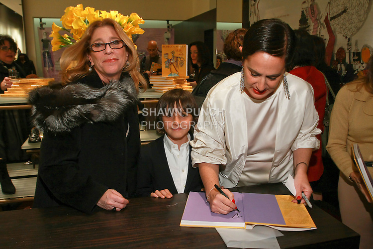 """Rebecca Moses signs book at the Rebecca Moses """"A Life of Style"""" book signing at Fratelli Rossetti Boutique, November 11, 2010."""