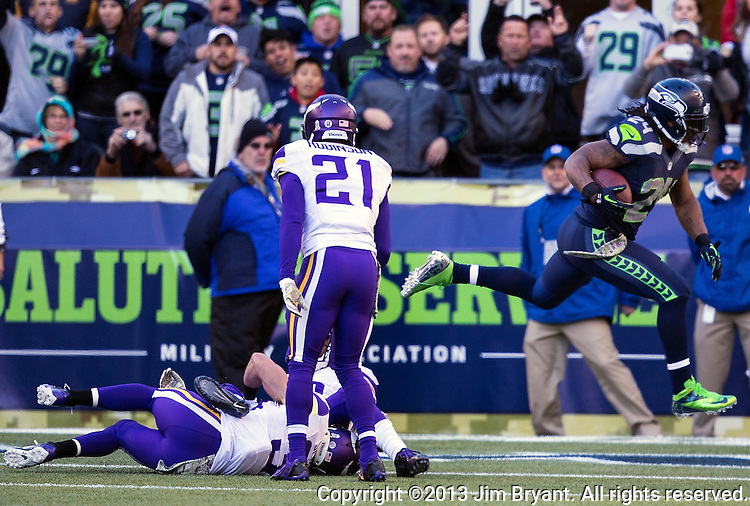 Seattle Seahawks running back Marshawn Lynch leaps into the end zone for a touchdown against the  Minnesota Vikings at CenturyLink Field in Seattle, Washington on  November 17, 2013.  Lynch ran for 54 yards and scored two touchdowns in Seahawks 41-20 win over the Vikings.  ©2013.  Jim Bryant. All Rights Reserved.