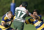 C. Luteru tries to get through the tackles of B. Maloney & M. Sa'u. Counties Manukau Premier Club Rugby, Patumahoe vs Manurewa played at Patumahoe on Saturday 6th May 2006. Patumahoe won 20 - 5.