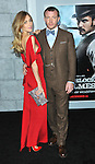 Director Guy Ritchie and date Jacqui Ainsley arriving at the Sherlock Holmes A Game Of Shadows Premiere, held at The Village Theater in Westwood, December 6, 2011.