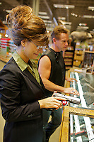 Arnold Schwarzenegger and Sarah  Palin impersonators handle magnum pistols while looking for a gun prop for a Sarah Palin impersonation act during the Sunburst Convention of Professional Tribute Artists