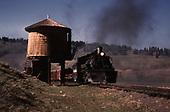 D&amp;RGW #493 with freight at Los Pinos water tank.<br /> D&amp;RGW  Los Pinos, CO