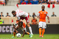 Eric Alexander (12) of the New York Red Bulls goes over the top of Ricardo Clark (13) of the Houston Dynamo. The New York Red Bulls defeated the Houston Dynamo 2-0 during a Major League Soccer (MLS) match at Red Bull Arena in Harrison, NJ, on June 30, 2013.