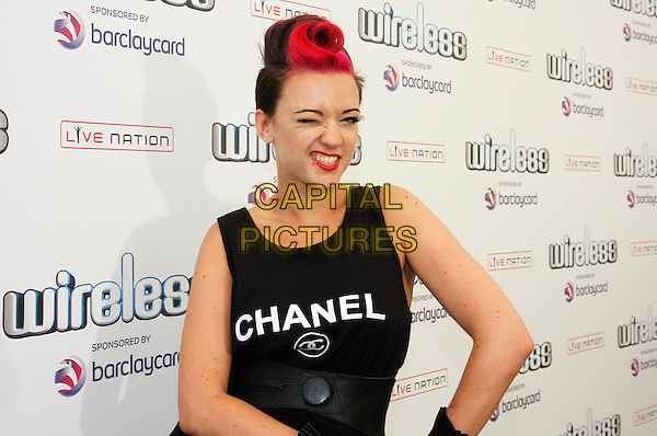 LAURA STEEL .at Wireless Festival 2010, Hyde Park, London, England, UK, July 4th 2010..concert gig music backstage half length Chanel vest top sleeveless logo  red hair quiff dyed  eye funny winking wink .CAP/MAR.© Martin Harris/Capital Pictures.