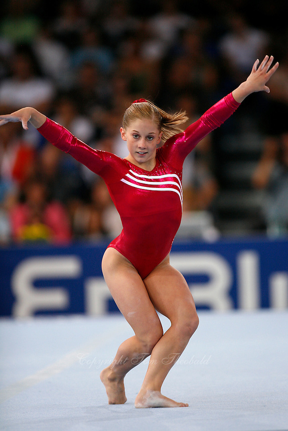 September 2, 2007; Stuttgart, Germany;  Shawn Johnson of USA performs on floor exercise during team qualifications in women's artistic gymnastics at 2007 World Championships. Johnson went on to win the women's All-Around gold medal. Photo by Copyright 2007 by Tom Theobald.