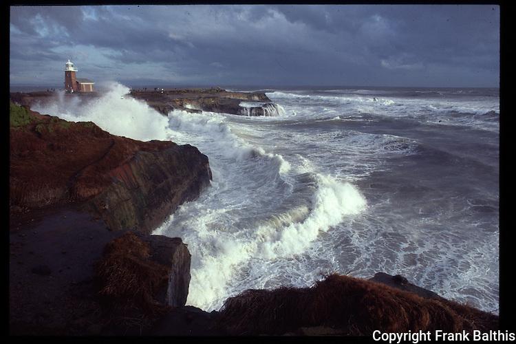 Storm surf at Lighthouse Point in Santa Cruz