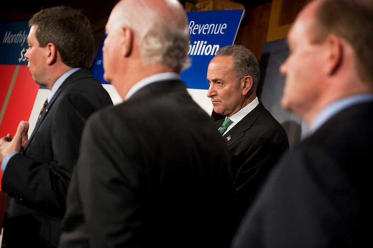 UNITED STATES - JULY 14:  From left, Sens. Mark Begich, D-Alaska, Ben Cardin, D-Md., Charles Schumer, D-N.Y., and Chris Coons, D-Del., conduct a news conference in the Capitol on the impasse in debt ceiling talks.  (Photo By Tom Williams/Roll Call)