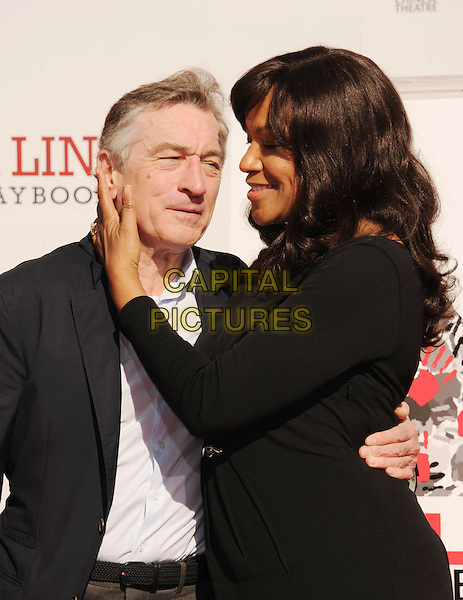 Robert De Niro & Grace Hightower.Hand and Footprint Ceremony held at the TCL Chinese Theatre, Hollywood, California, USA..4th February 2013.half length dress side profile married husband wife arm around waist black jacket blue white shirt.CAP/ROT/TM.© TM/Roth/Capital Pictures