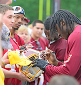 Washington Redskins quarterback Robert Griffin III signs autographs after participating in the last day of OTAs at Redskins Park in Ashburn, Virginia on Thursday, June 6, 2013.<br /> Credit: Ron Sachs / CNP