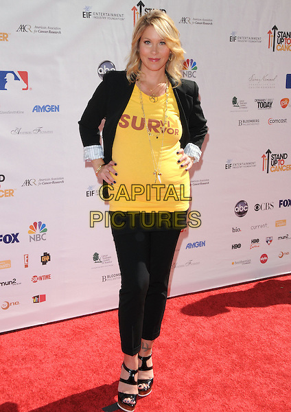 CHRISTINA APPLEGATE .at Stand Up to Cancer held at Sony Picture Studios in Culver City, California, USA, September 10th 2010.     .full length black blazer jacket yellow t-shirt survivor trousers cropped platform sandals pregnant hands on hips .CAP/RKE/DVS.©DVS/RockinExposures/Capital Pictures.
