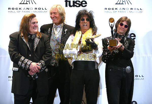 MICHAEL BRUCE, NEAL SMITH, ALICE COOPER & DENNIS DUNAWAY.The press room at the 26th annual Rock and Roll Hall of Fame Induction Ceremony at The Waldorf-Astoria, New York City, New York, NY, USA..March 14th, 2011.half length white shirt snake boa python black gloves make-up fake false blood award trophy winner studs studded sunglasses shades jacket.CAP/ADM/PZ.©Paul Zimmerman/AdMedia/Capital Pictures.