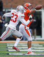 Pressure from Ohio State Buckeyes defensive back Tyvis Powell (23) forces an incomplete pass by Illinois Fighting Illini quarterback Nathan Scheelhaase (2)at Memorial Stadium in Champaign, Illinois on November 16, 2013.  (Chris Russell/Dispatch Photo)