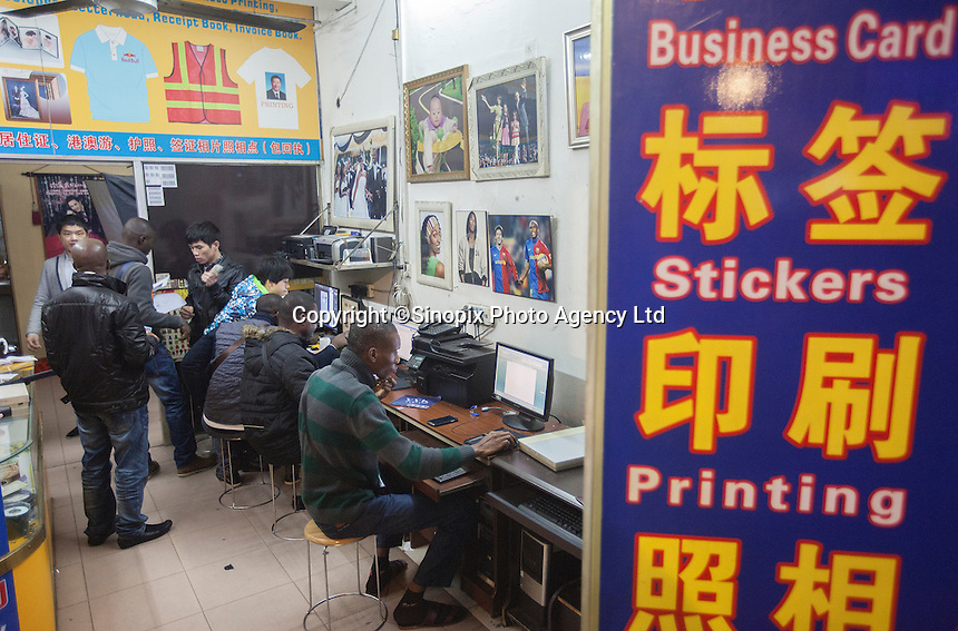 African men use the internet in a Chinese-run copy shop  in an area of Guangzhou known to locals as 'Chocolate City', Guangzhou, Guangdong Province, China, 08 December 2014. The health authorities of Guangzhou are said to be stepping up their monitoring of the African community in light of the ongoing outbreak of the Ebola virus disease in West Africa.