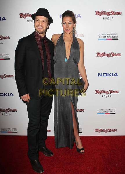 Gavin DeGraw, Colbie Caillat.Rolling Stone American Music Awards 2012 After Party Held At Rolling Stone Restaurant & Lounge (RSLA), Hollywood, California, USA..November 18th, 2012.AMA AMAs full length maroon red shirt black suit jacket tie hat beard facial hair grey gray halterneck dress low cut neckline turquoise blue necklace clutch bag     .CAP/ADM/KB.©Kevan Brooks/AdMedia/Capital Pictures.