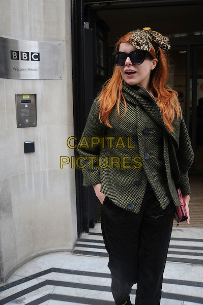PALOMA FAITH.Seen outside BBC Radio 2 Building, London, England, UK, April 30th 2010..half length sunglasses green grey gray jacket coat trousers  oversized leopard animal print brown head scarf hair band hairband red clutch bag purse hand in pocket 3/4.CAP/IA.©Ian Allis/Capital Pictures.