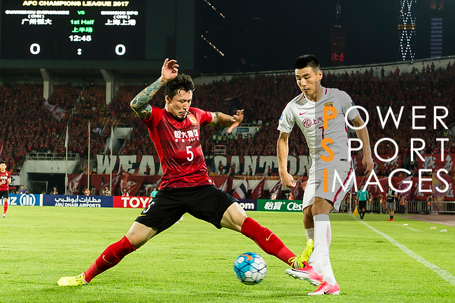 Shanghai FC Forward Wu Lei (R) in action against Guangzhou Defender Zhang Linpeng (L) during the AFC Champions League 2017 Quarter-Finals match between Guangzhou Evergrande (CHN) vs Shanghai SIPG (CHN) at the Tianhe Stadium on 12 September 2017 in Guangzhou, China. Photo by Marcio Rodrigo Machado / Power Sport Images
