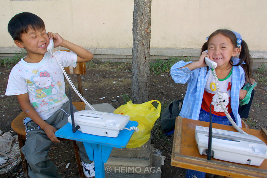 ULAN BATOR, MONGOLIA..08/21/2001.Small public phone businesses operating with wireless phones near Sukhbaatar Square..(Photo by Heimo Aga)
