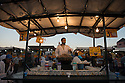 Man cooking snails on food stall in Djemaa el-Fna, Marrakech.