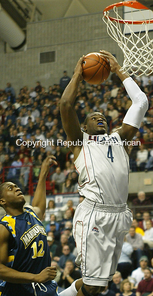 Storrs, CT-20 January 2008-012001MK03 UConn's  #4 Jeff Adrien goes up for a slam dunk against Marquette during Sunday's game at Gampel Pavilion.  Connecticut won the contest 89 - 73 over the Golden Eagles. Michael Kabelka / Republican-American (#12 A.J. Price drives to the hoop against Marquette's  #1 Dominic James)CQ