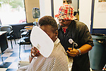 Ayo Arama looks at her new mohawk cut by Barber and shop owner Alan Skipworth at All Star Stylez Barbershop in East Atlanta, Georgia, July 25, 2013.