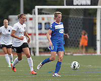 Boston Breakers midfielder Joanna Lohman (11) controls the ball as Portland Thorns FC forward Danielle Foxhoven (9) closes. In a National Women's Soccer League (NWSL) match, Portland Thorns FC (white/black) defeated Boston Breakers (blue), 2-1, at Dilboy Stadium on July 21, 2013.