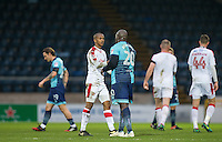 Lewis Young of Crawley Town shakes hands with Adebayo Akinfenwa of Wycombe Wanderers at full time during the Sky Bet League 2 match between Wycombe Wanderers and Crawley Town at Adams Park, High Wycombe, England on 25 February 2017. Photo by Andy Rowland / PRiME Media Images.
