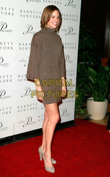 """HILARY SWANK.""""The Palazzo Las Vegas"""" Hotel Casino - Grand Opening at Barneys New York and The Shoppes at The Palazzo,  Las Vegas, Nevada, USA, 17 January 2008..full length brown polo neck sweater dress grey gray shoes.CAP/ADM/MJT.©AdMedia/Capital Pictures. *** Local Caption *** ."""