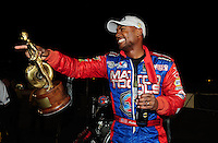 Nov 14, 2010; Pomona, CA, USA; NHRA top fuel dragster driver Antron Brown celebrates after winning the Auto Club Finals at Auto Club Raceway at Pomona. Mandatory Credit: Mark J. Rebilas-