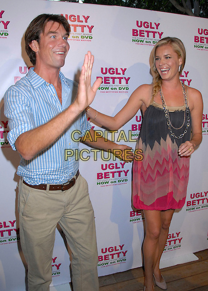 "JERRY O'CONNELL & REBECCA ROMIJN.""Ugly Betty"" First Season DVD Launch Event at the Mondrian Hotel, West Hollywood, California, USA..August 20th, 2007.full 3/4 length blue braid plait couple checkered shirt necklaces chain grey gray pink pattern dress hand funny face gesture .CAP/ADM/BP.©Byron Purvis/AdMedia/Capital Pictures"
