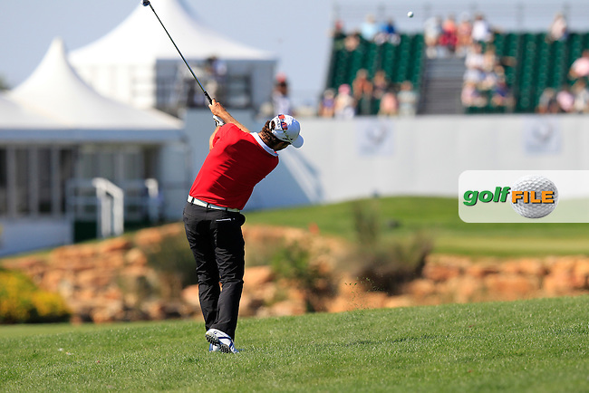 Alejandro Canizares (ESP) plays his 2nd shot on the 18th hole during Thursday's Round 1 of the 2013 Portugal Masters held at the Oceanico Victoria Golf Club. 10th October 2013.<br /> Picture: Eoin Clarke www.golffile.ie