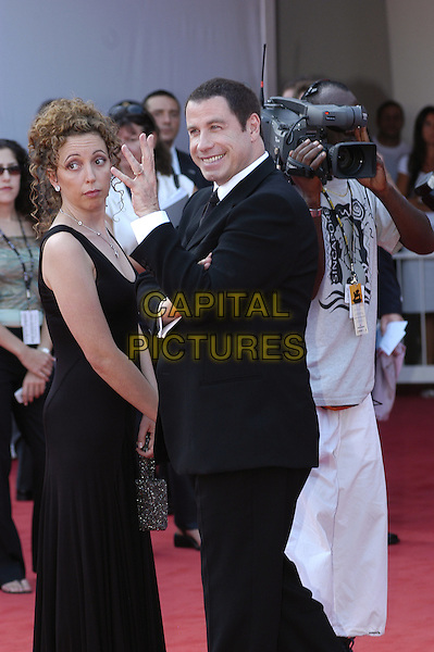 SHAINEE GABEL & JOHN TRAVOLTA.61st Venice Film Festival.September 2nd, 2004.half length, waving, gesture.www.capitalpictures.com.sales@capitalpictures.com.© Capital Pictures.