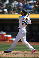 OAKLAND, CA - MAY 12:  Matt Olson #28 of the Oakland Athletics hits a home run against the Cleveland Indians during the game at the Oakland Coliseum on Sunday, May 12, 2019 in Oakland, California. (Photo by Brad Mangin)